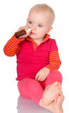 Little baby girl spraying herself nose spray  on white Stock Photos