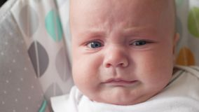 Little baby starting to cry. the child is going to cry. Little baby starting to cry. the child is going to cry stock video footage