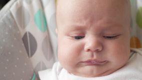 Little baby starting to cry. the child is going to cry. Little baby starting to cry. the child is going to cry stock video