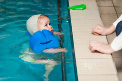 Little baby swimming in water Stock Images