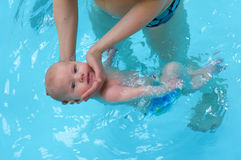 Little baby swimming in water Royalty Free Stock Photography