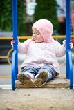 Little baby in a swing Stock Images
