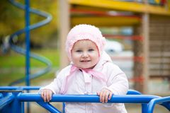Little baby in a swing royalty free stock photography
