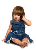 Little baby is talking on cell phone, isolated over white Royalty Free Stock Photos
