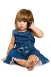 little baby is talking on cell phone, isolated over white Royalty Free Stock Photo