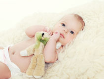 Little baby with teddy bear Royalty Free Stock Images