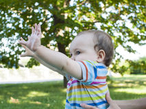Little baby tent hands up. Royalty Free Stock Photography