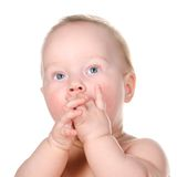 Little baby is thoughtfully looking sideways Stock Photo
