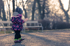 Little baby toddler exploring cold outside world in park Stock Image