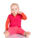 Little baby girl with toothbrush  on white background Stock Images