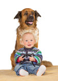 Little baby with trusted family dog Stock Photography