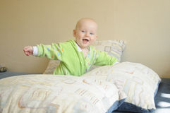 Little baby is trying to stand up Royalty Free Stock Images