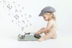 Baby with typewriter. Little baby typing with a typewriter Royalty Free Stock Photography