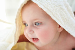 A little baby under a white towel Royalty Free Stock Photography