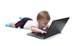 Little baby using laptop Stock Photos