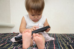 Little baby using Tablet PC touch screen Stock Image