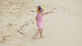 Little baby walking to the sea stock footage