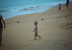 Little baby walking to the sea Royalty Free Stock Photography