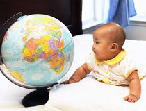 Little baby watches global Royalty Free Stock Image