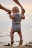 Little baby by the water Stock Photos