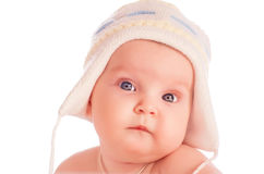 Little baby wearing warm wool hat. Royalty Free Stock Image
