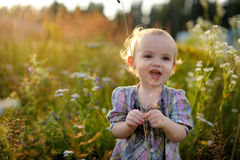 Little baby in the weeds. Little smiling baby is in the weeds Royalty Free Stock Images