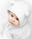 Little baby in white bear costume Stock Image