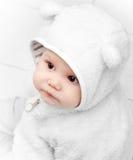 Little baby in white bear costume Stock Image