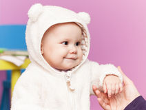 Little baby in white bear costume smiles Royalty Free Stock Photos