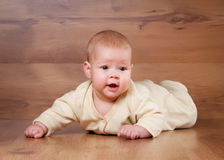 Little baby on wooden texture Stock Photo