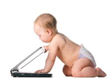 Little baby is working on laptop Royalty Free Stock Image