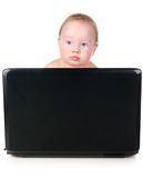 Little baby is working on laptop Stock Images