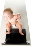 Little baby is working on laptop Royalty Free Stock Photo