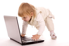 Little baby writing on the laptop Royalty Free Stock Photos