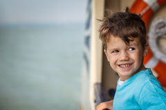 Little bad boy on deck ship Stock Photography