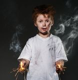 Little bad boy. Little redhead bad boy with sparkling wires stock image