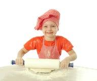 Little baker. Little cute baker preparing dough Stock Photo