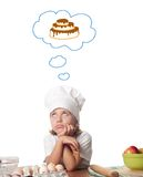 Little baker. Photo of little baker adorable, pretty little caucasian girl in chef hat. Cooking concept Royalty Free Stock Photography