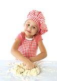Little baker. Little messy baker kneading dough Stock Photos