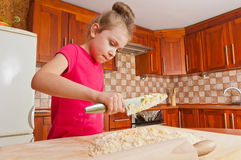 Little baker with big knife Royalty Free Stock Photos
