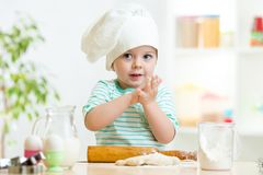Little baker child girl in chef hat Royalty Free Stock Image