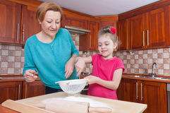 Little baker and her mom Stock Photo