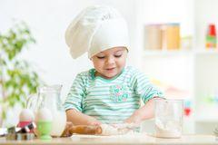 Little baker kid girl in chef hat Royalty Free Stock Photos