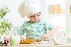 Little baker kid girl in chef hat Stock Photography