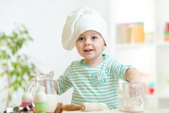 Little baker kid girl in chef hat Royalty Free Stock Images