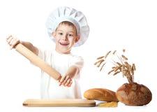 Little baker is kneading dough Stock Photos