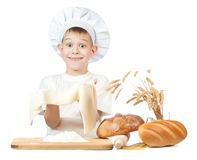 Little baker is kneading dough Royalty Free Stock Images