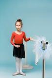 The little balerina dancer on blue background Stock Photo