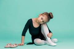 The little balerina dancer on blue background Stock Photos