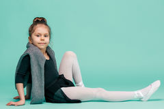 The little balerina dancer on blue background Royalty Free Stock Image